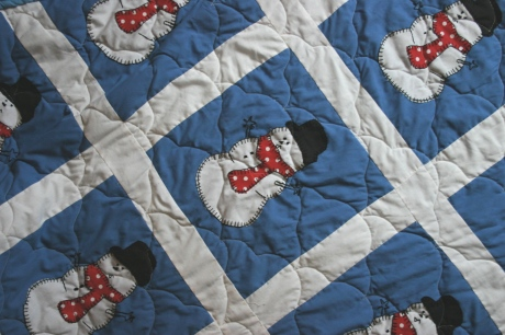 A quilt made for Benjamin's big boy bed... (My sister designed the snowmen because Mama can't draw.)